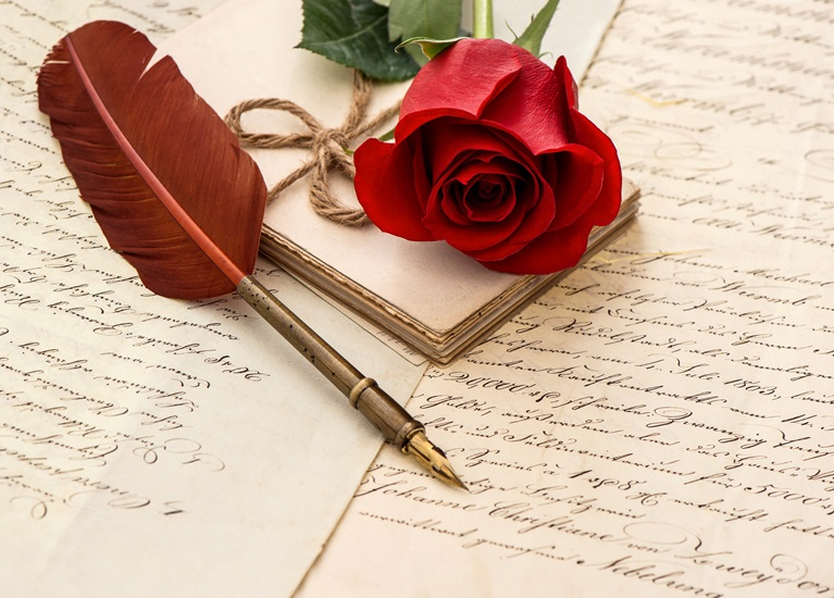 red rose flower, old letters and antique feather pen. sentimental vintage background